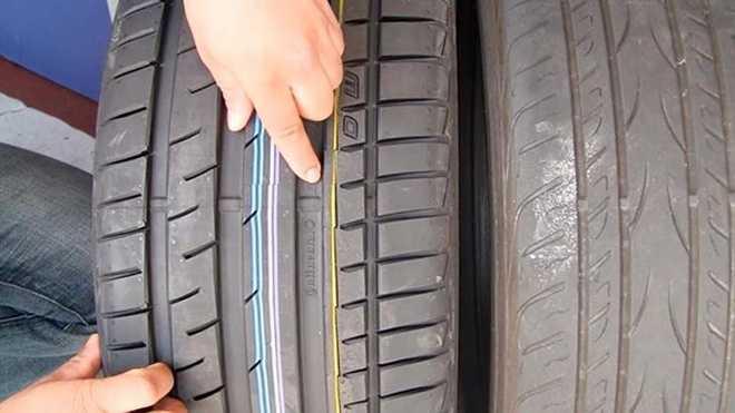 kiểm tra 2 đường chỉ xanh, đỏ chạy dọc trên gai lốp